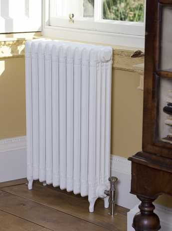 Decorative cast iron radiator fitted with traditional valve