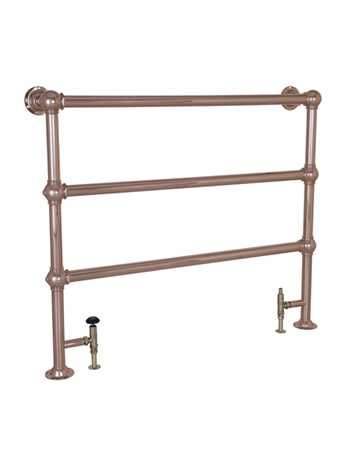 Heated floor mounted towel rail in copper