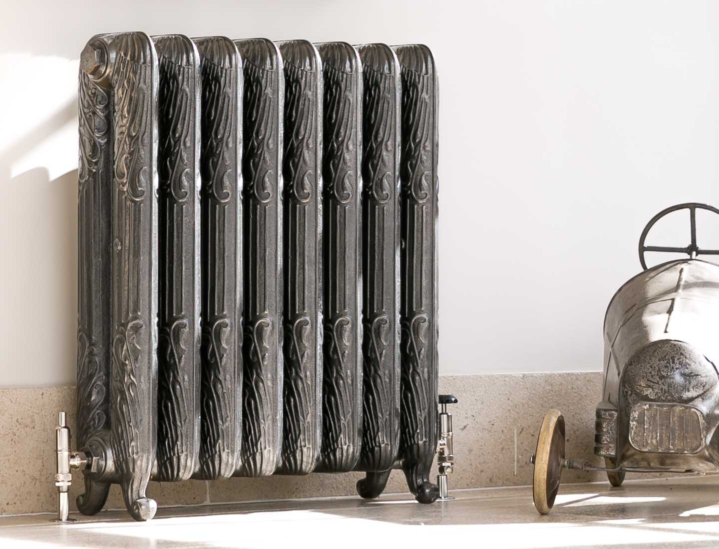 Peacock hand burnished cast iron radiator