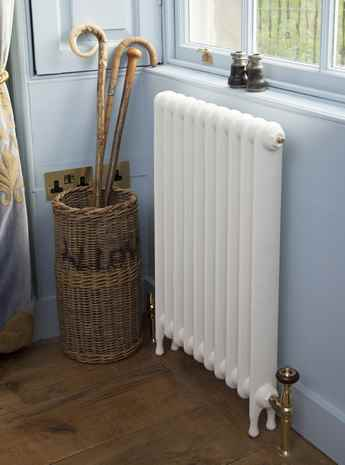 Narrow Avery cast iron 1 column radiator painted in parchment white
