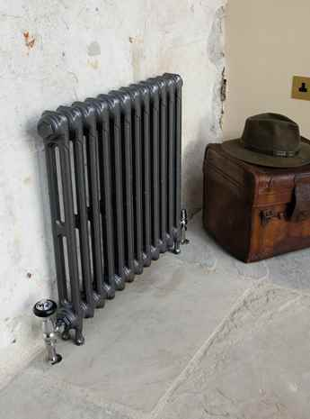 Victoriana cast iron radiator painted in foundry grey