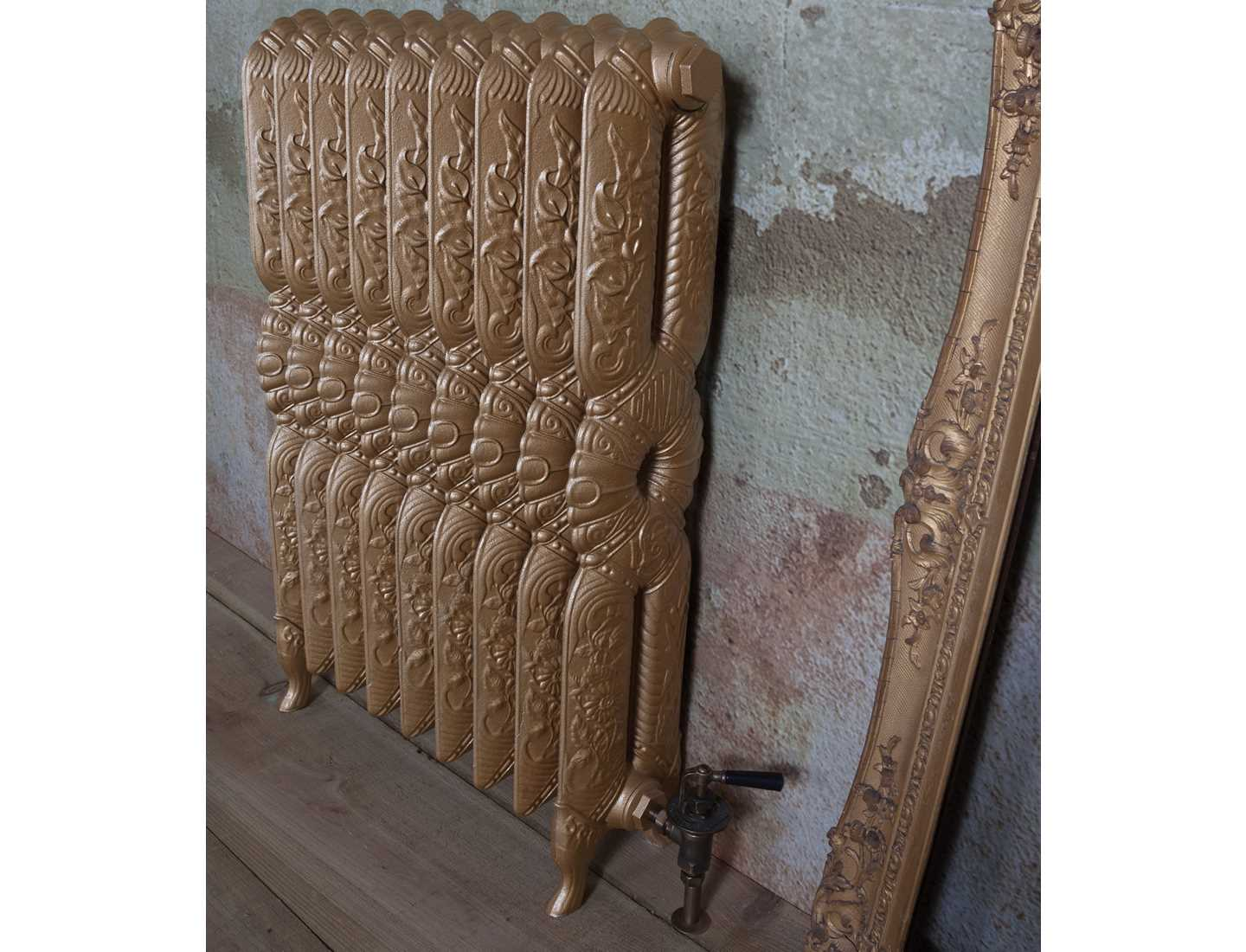 Decor radiator painted in hammered gold